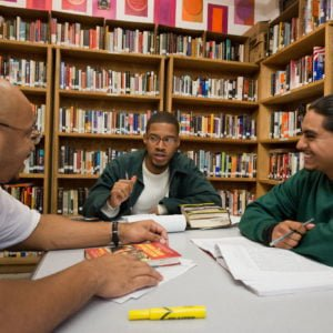 students discussing in library