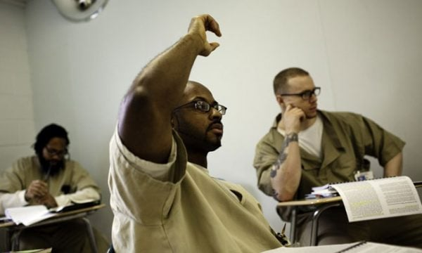 Student from Wesleyan University's Center for Prison Education (CPE) in Connecticut raises his hand during class. Photo by Christopher Capozziello