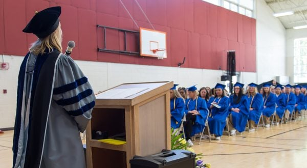 Tanya Erzen delivering a speech to graduates at the Washington Corrections Center for Women.