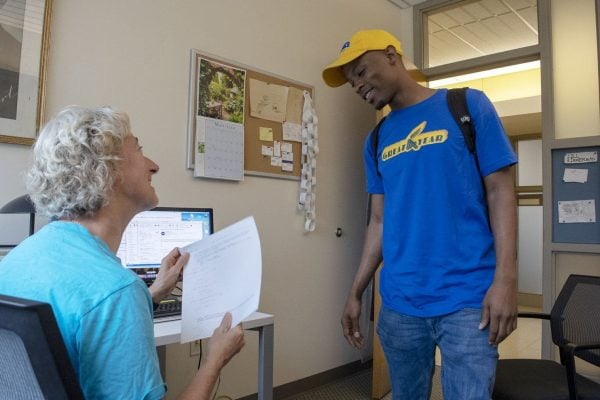 Goucher College student Donte Small turning in his final exam to professor Jill Zimmerman.