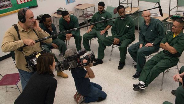 BPI students being interviewed in prison by documentary crew