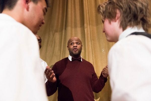 "<strong>Reggie Chatman, 39, chats with Andrew Tang and Christoph Marshall, who are part of the debate team at the University of Cambridge. Chatman, who is on Bard College's prison debate team, thanked them ""for taking us seriously.""</strong> (Michael Noble for The Washington Post)"