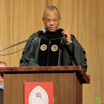 Faculty member giving speech during BPI's 10th Commencement