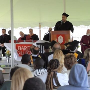Faculty giving speech at BPI's 11th Commencement