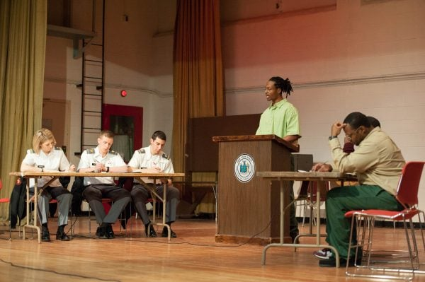 BPI debate team on stage with West Point team