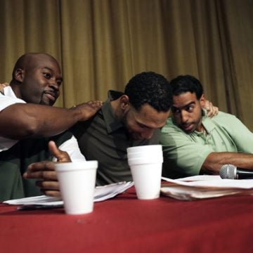 Prison inmates and members of the Bard Prison Initiative debate team, from left: Carl Snyder, Dyjuan Tatro and Carlos Polanco embraced after winning a debate against Harvard at the Eastern New York Correctional facility in 2015. PHOTO: PETER FOLEY FOR THE WALL STREET JOURNAL