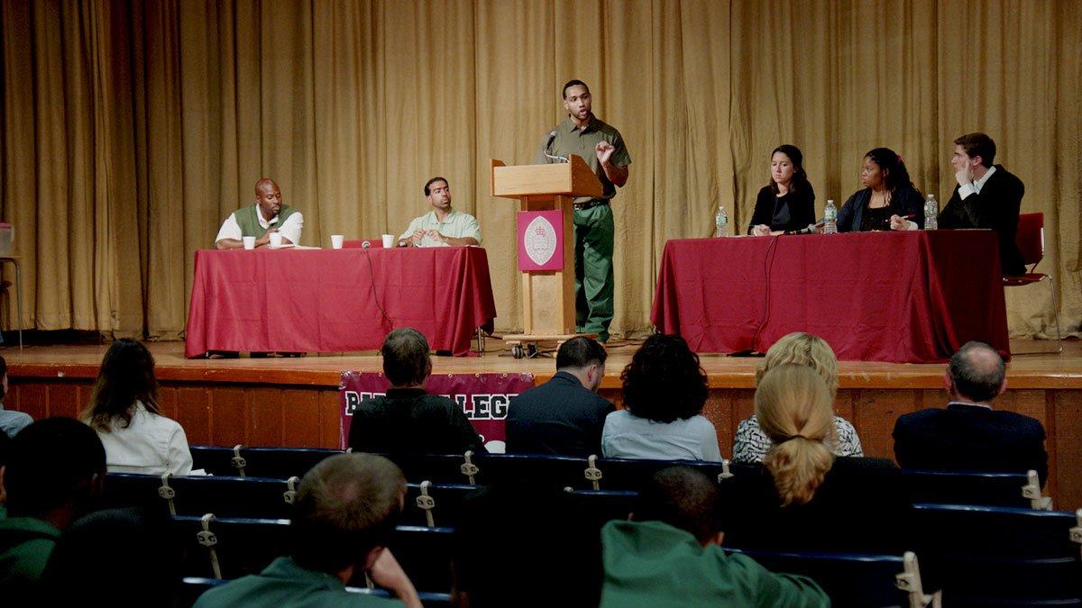 BPI Debate Union students vs. Harvard debate students on stage.