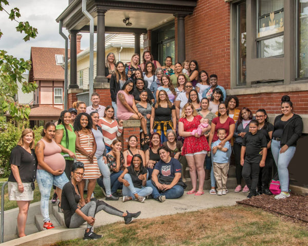 A group of students (the Fall 2019 Cohort) outside of the Care Center