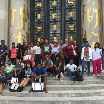 A group of students on the steps of the Brooklyn Public Library