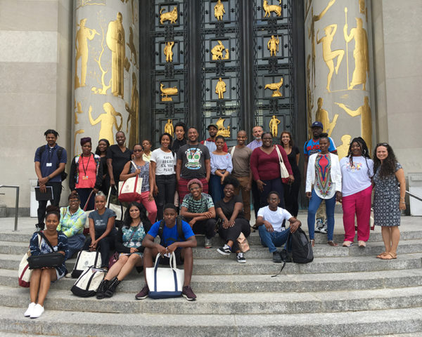 A group of students (the 2018 Cohort) on the steps of the Brooklyn Public Library